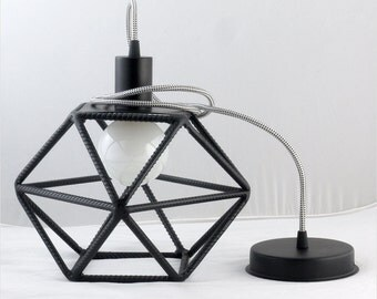 Pendant lamp. Loft cage for bulb, with textile cable. lamp with steel rods.