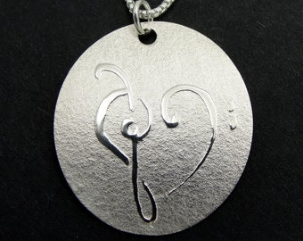 Sterling Silver Disc Necklace with Treble and Bass Clef Heart