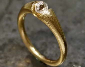 Rose gold ring with rough diamond