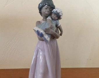 Lladro retired Black Legacy Collection: Niña con Muñeca (Girl with Doll)