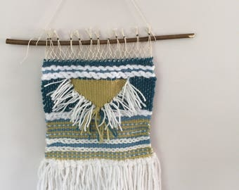 Woven wall hanging in lime and teal.