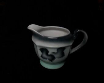 Creamer is vintage 1950s ceramic porcelain