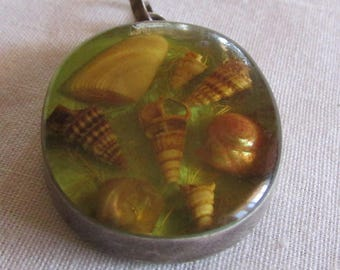 Sterling Silver Pendant with Shells Embedded in Lucite