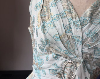 1950s blue brocade cocktail dress with poodle charm