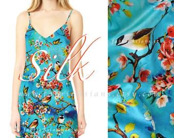 Bird fabric cyan blue silk by Global EXPRESS