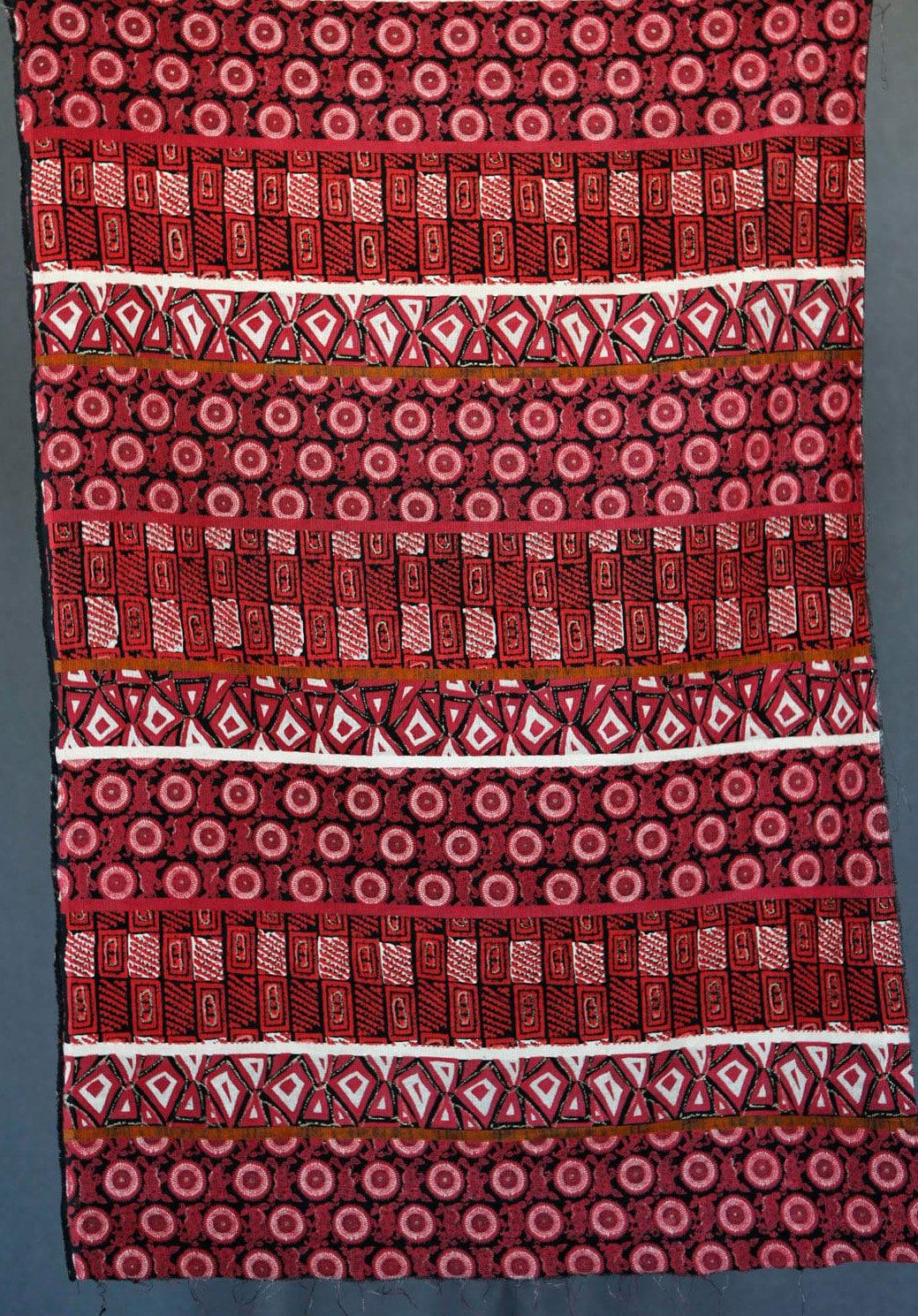 Pink red black corduroy fabric with circular geometric