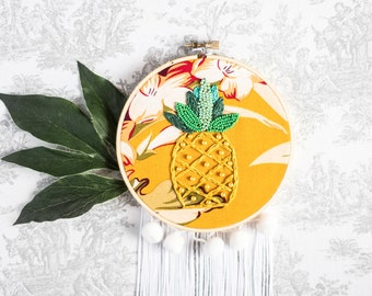 A colorful embroidery of a pineapple
