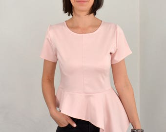 Peplum top in pale rose.