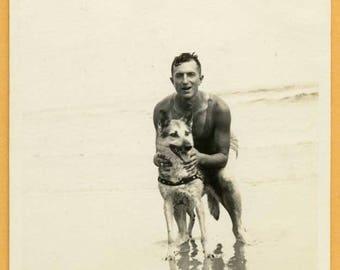 Original Vintage Snapshot Found Photo Vernacular Photo 1930s Handsome Man posing with German Shepherd Dog in Water at Beach  -C28