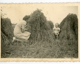 Vintage photo 'Hide and Seek' vernacular photos snapshot, mother and child, outdoors, hay stack playful, country side, young girl kids
