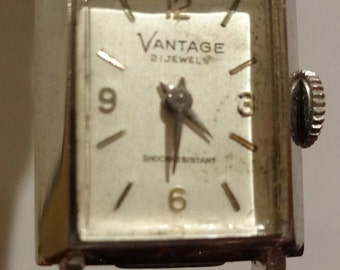 Ladies watch Vantage tank Watch by Hamilton Watch Company.  Works great new band. 21 jewels