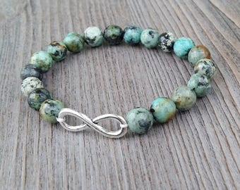Infinite bracelet made of 8mm African turquoise stones faceted