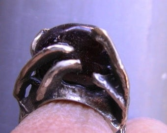 cast silver ring, dark red garnet