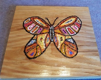 Butterfly dot art on wooden plaque