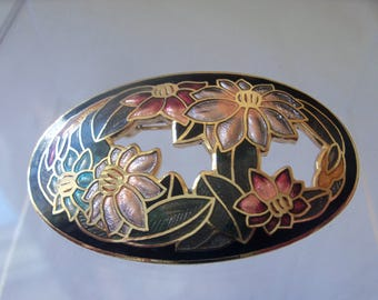 Decorative oval cloisonne enamel flower motif brooch with cut-out sections