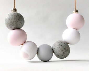 Soft pink and grey clay beaded necklace
