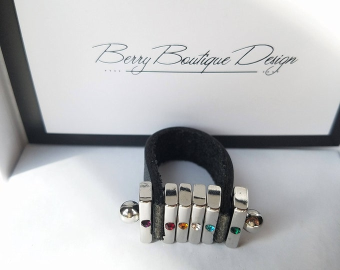 Featured listing image: Ring, Black Leather Band, Silver finish slider with rainbow center beads,  size 7