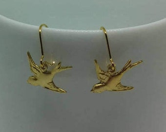 Silver earrings with gold-plated and raw brass birds charms