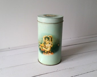 Old tin with romantic print