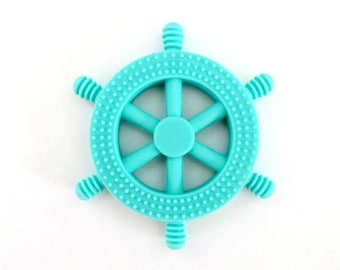 Teething toy, silicone toy, chew toy for babies, pacifier clip attachement, turquoise wheel