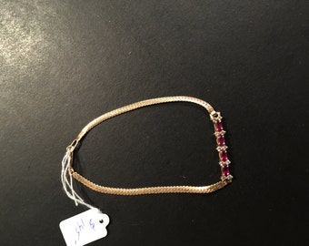 "Nice 14kt. yellow gold ladies bracelet with garnets.  5.5"" closed."