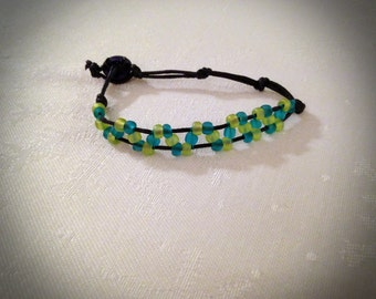 Rustic Adjustable Teal and Light Green Beaded Whirl Bracelet with Navy Blue Cord