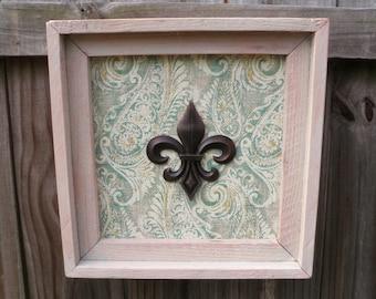Fluer de Lis in rustic cedar frame