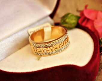 A wedding ring in the style of Versace. 18K gold filled