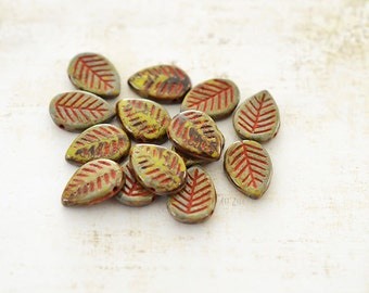 10 beads, Czech pressed glass leaves, green moss and red, 16 x 12 mm