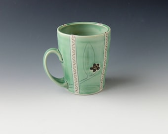 Ceramic Coca Mug - green porcelain clay cup with leaves, flowers, and money decals - wheel thrown handmade pottery