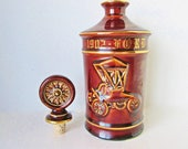 Ford Runabout Bottle, Decanter Clem Harvey, Brown Hall Porcelain embossed round bottle liquor decanter wheel stopper with cork, gold writing