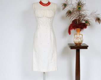Vintage 1950s Dress - Wonderfully Textured White Matte Brocade Wiggle Dress with Gathered Chiffon Shelf Bust and Rhinestone Sparkle - Chalet