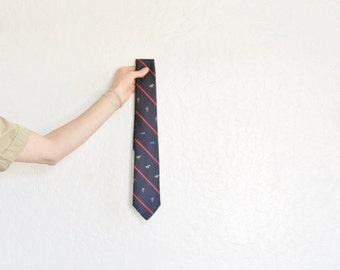 tiny hot air balloon print necktie . race horses and steamboats too . navy blue menswear