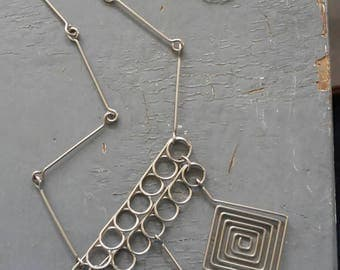 Spiral - unique geometric trio,  spiral metalwork & interlocking hinged statement necklace