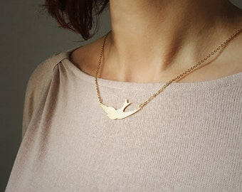 Flying swallow bird necklace in gold or silver