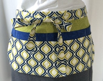 Utility Apron/Teacher Apron with 8 pockets and loop in green navy and cream tear drop fabric