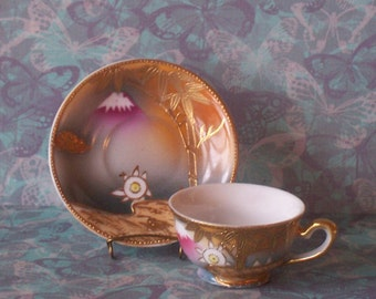 Miniature Occupied Japan Teacup with beautiful embossed gold tree and landscape