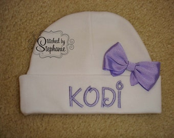 Custom personalized monogrammed personalized name white newborn baby hat with purple bow