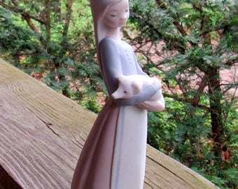 lladro statue girl with pig