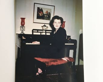 vintage color photo of woman sitting at piano
