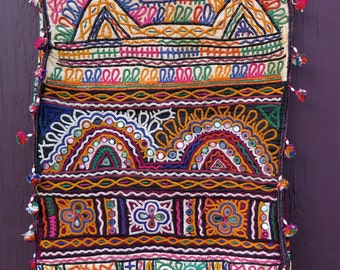 Vintage Indian dowry bag textile wall hanging
