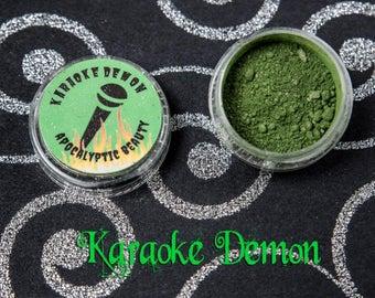 Karaoke Demon - vegan green eyeshadow with red duochrome and sparkle