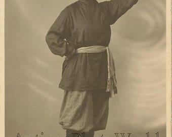 Pretty woman dancer as cossack antique photo