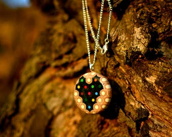 Ring shape necklace made of colored pencils with heart