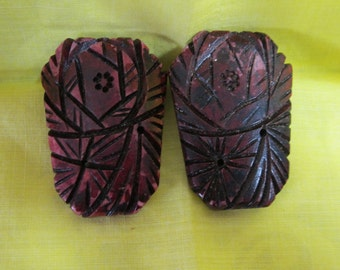 Carved celluloid vintage shoe clips; women's footwear ornamentation; 1930's