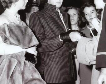 Elvis Presley ,  Elvis signing autographs in the 1950's
