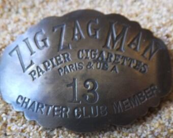 Vintage Zig Zag Brass Badge