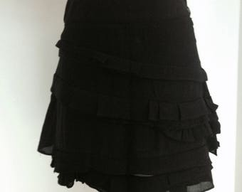 Black skirt has ruffles, SANDRO brand, size 36/S.