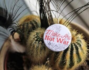 Make Art Not War 32mm pin back badge
