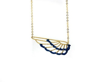 Long necklace, colorful wing